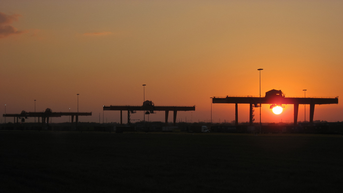 Large container cranes at sunset at the new BNSF intermodal facility in Gardner Kansas.