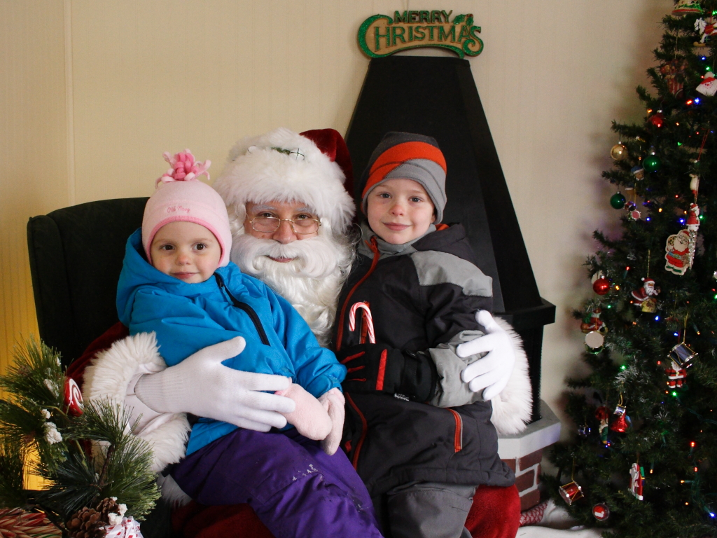 Lily and Nate with Santa at the Crystal Lake Santa house - 2013