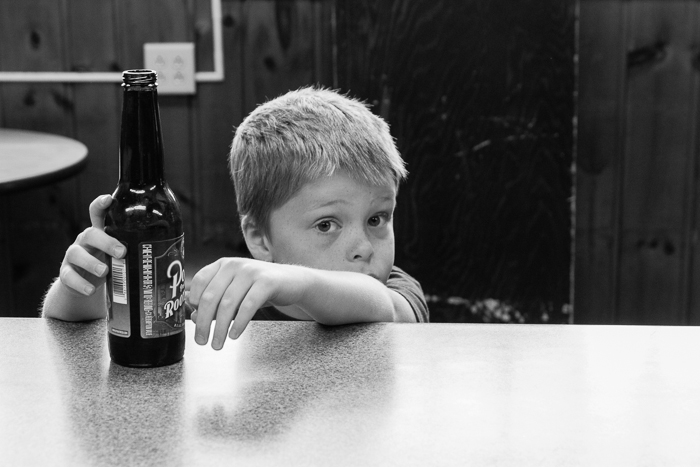 Nate at a bar in Rudolph, WI, drinking Point root beer.
