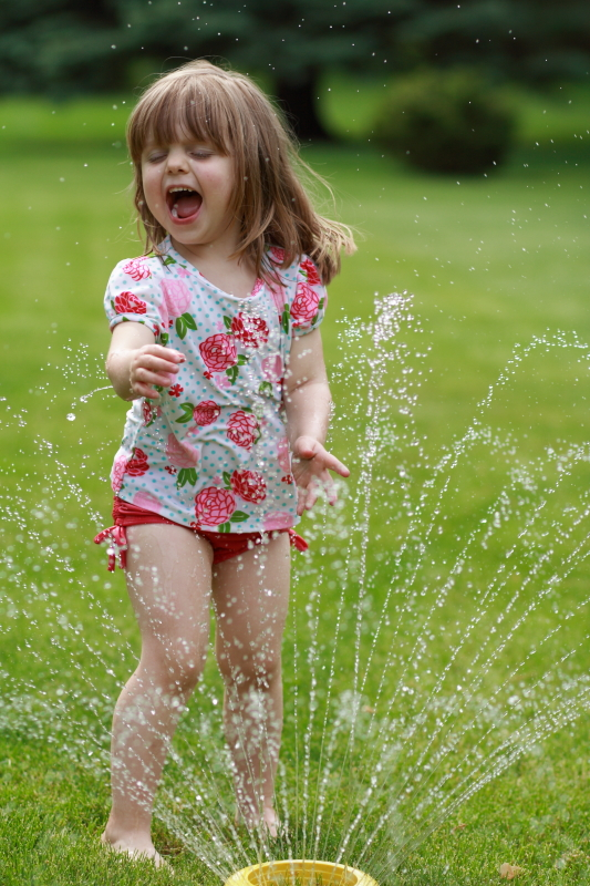 Lily enjoying a sprinkler. Memorial Day 2014