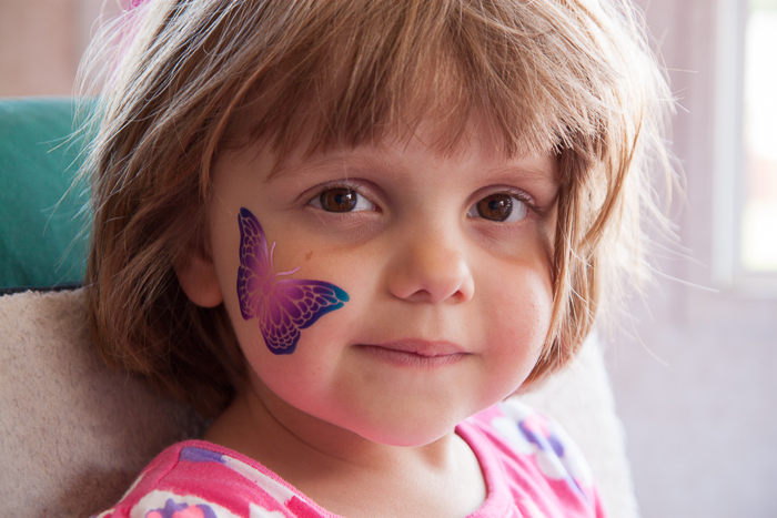 Lily at the McHenry County Fair after getting a temporary tattoo of a butterfly.