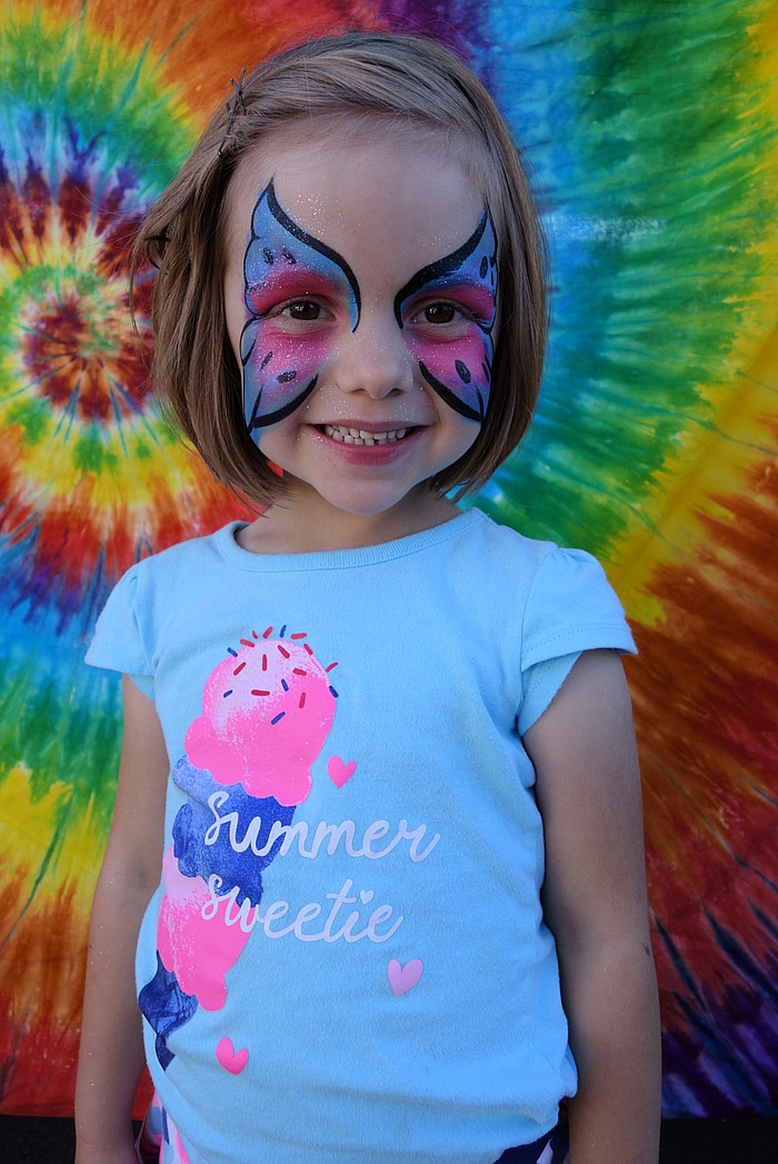 Lily with face paint from the Johnny Appleseed Festival.