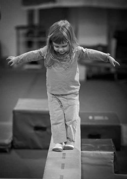 Lily on the practice balance beam at the Cary Gym