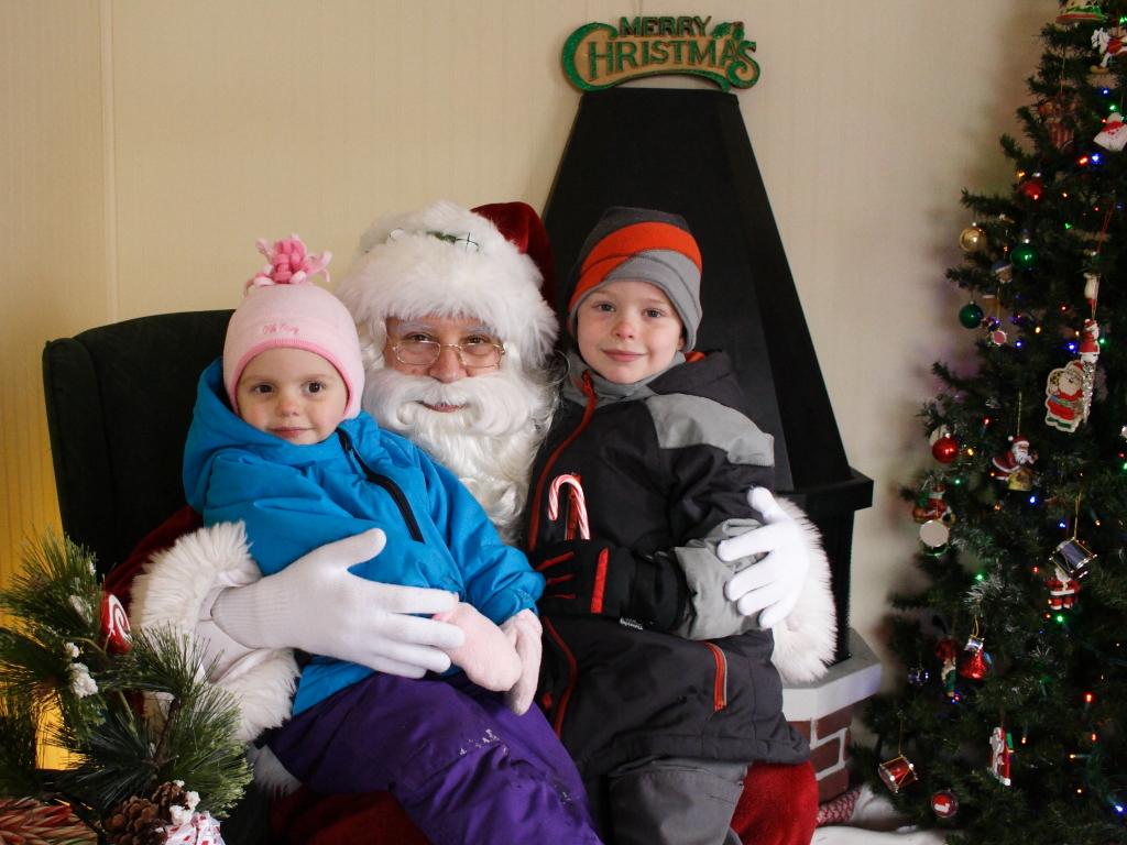 Lily and Nate with Santa at the Crystal Lake Santa house - 2013