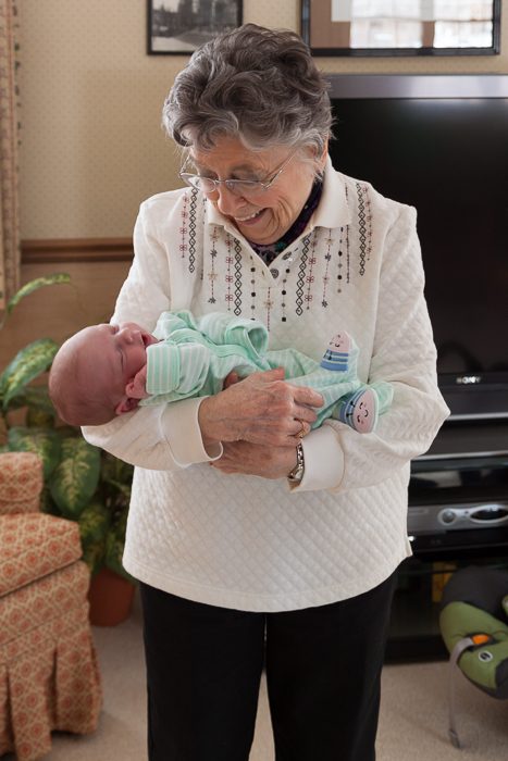 Great Grandma Amling holding James for the first time.
