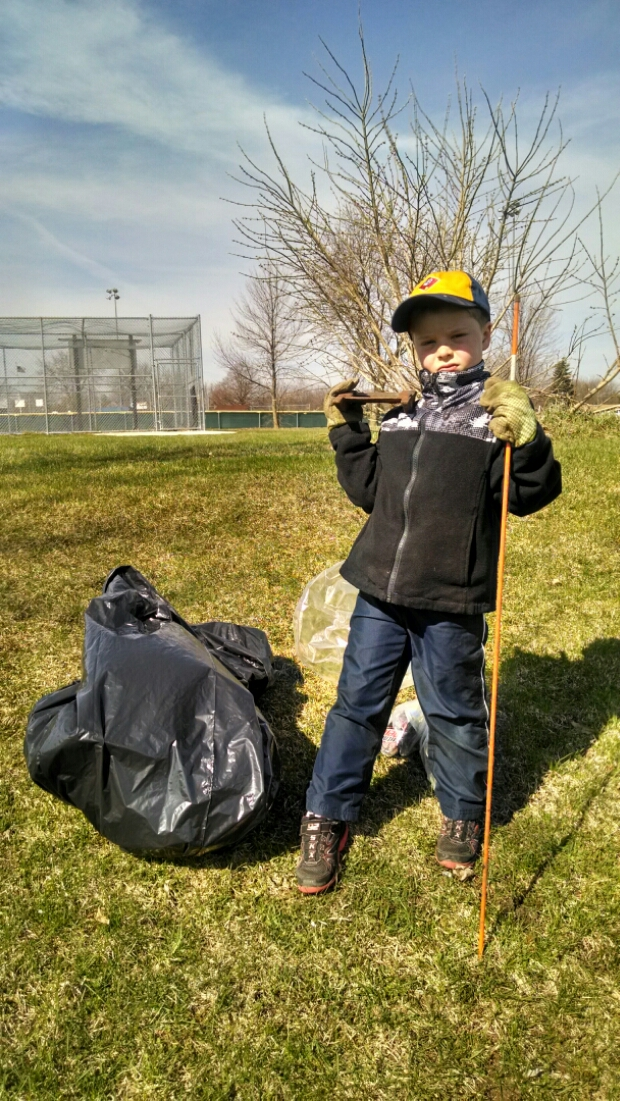 Earth Day Cleanup with Nate. Here he is pictured with his haul of trash we collected from a local park