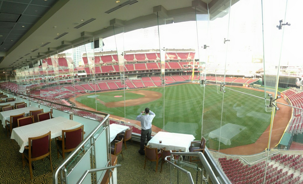 During a recent business trip to Cincinnati I was able to go on a behind-the-scenes tour of the Cincinnati Reds stadium, followed by a dinner in the Riverfront Club.  Here's a fellow event-goer photographing the stadium from the Riverfront Club.