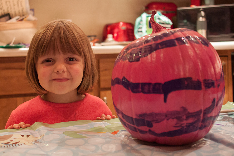 Lily was proud of her decorated pumpkin.