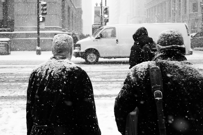 Pedestrians covered in snow walking in the Loop, Chicago