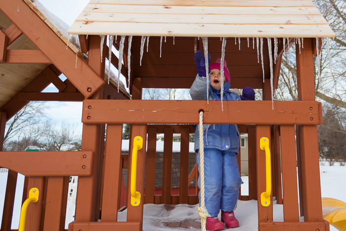 Lily was, clearly, amazed by the icicles on our swing-set.