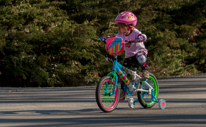 Lily is so determined to get up the hill on her bike, her whole body shows it.