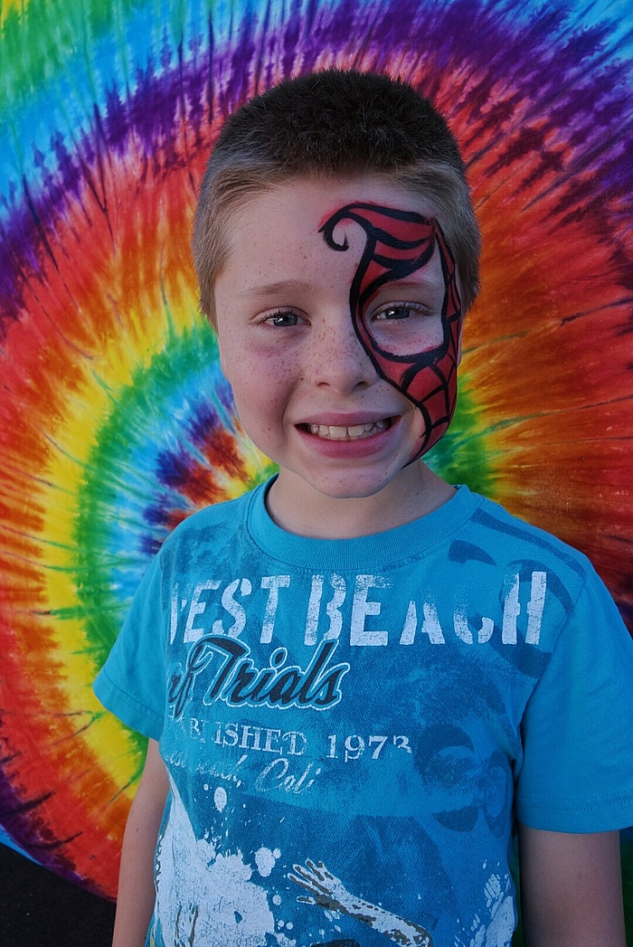 Nate with face paint from the Johnny Appleseed Festival.